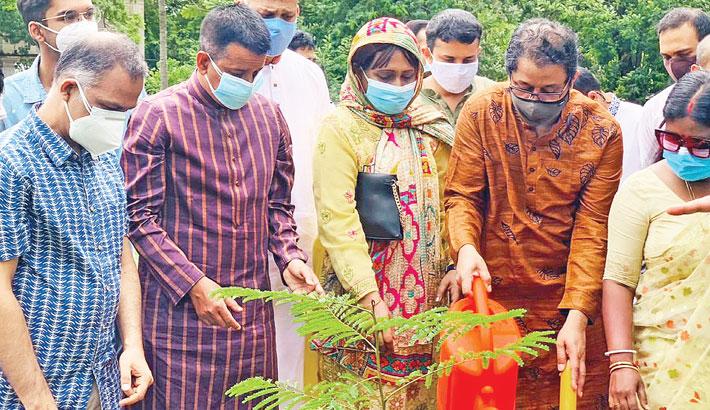 Guests attend a tree plantation programme on Kali Mandir premises on Dhaka University campus on Friday. Prof Zakaria Swapan Smriti Sangsad organised the event.
