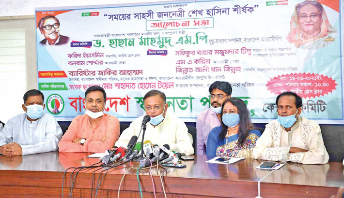 Information and Broadcasting Minister Dr Hasan Mahmud speaks at a discussion on the bravery of Awami League President and Prime Minister Sheikh Hasina at National Press Club in the capital on Saturday. President of the club Farida Yasmin was present. — SUN PHOTO