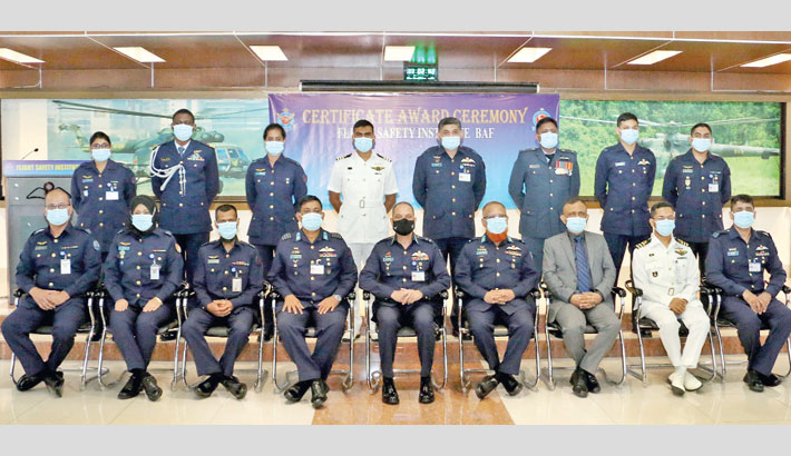 Participants in 'No 10 Aircraft Accident Investigation Course' pose for a photo with Air Officer Commanding of BAF Base Bashar Air Vice-Marshal Muhammad Nazrul Islam after completion of the course at Flight Safety Institute of Bangladesh Air Force on Sunday.