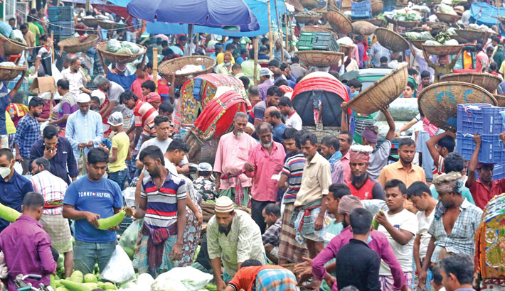 People are still reluctant to abide by the health guidelines, including wearing masks and keeping distance with others, although the coronavirus  situation has taken a serious turn in the country. The photo was taken from Karwan Bazar on Monday.—MD NASIR UDDIN