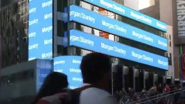 India: Students from Bangalore watch their photos beam from billboard at Times Square, NYC