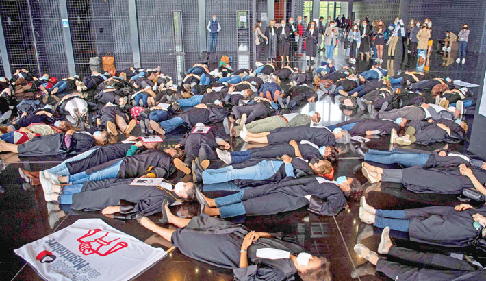 French lawyers and clerks lie on the ground of Nantes' courthouse during an action to call for more resources on Tuesday.– AFP PHOTO