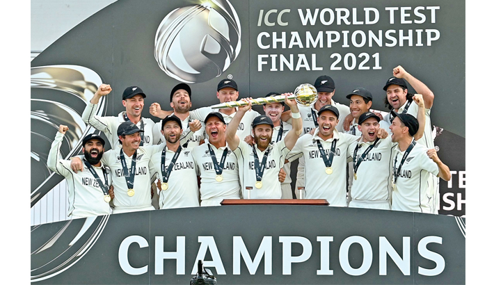 New Zealand captain Kane Williamson (centre) lifts the winner's Mace as New Zealand players celebrate victory on the final day of the ICC World Test Championship Final against India at Ageas Bowl in Southampton on Wednesday. NZ beat India by eight wickets in the inaugural WTC final.   – AFP photo