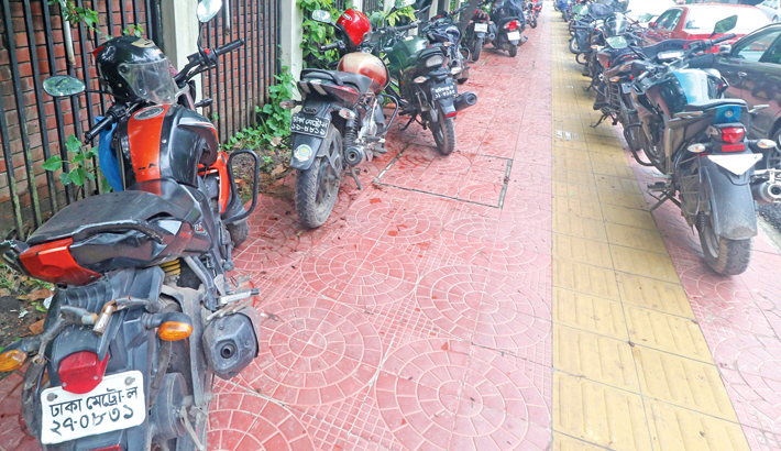 Motorcycles are parked illegally on a footpath at Minto Road in the capital, causing sufferings for pedestrians. The photo was taken on Thursday.  -  MD NASIR UDDIN