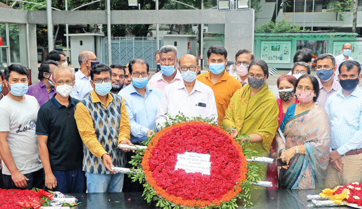Newly-appointed Vice-Chancellor (VC) of Bangladesh Open University (BOP) Professor Dr Syed Humayun Akhter along with other officials of BOP places a wreath at the portrait of Father of the Nation Bangabandhu Sheikh Mujibur Rahman in the city's  Dhanmondi 32 area on Wednesday. BOP Pro-VC, treasurer and registrar, among others, were present on the occasion.—SUN PHOTO
