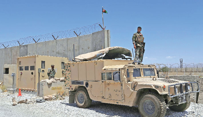 An Afghan National Army (ANA) soldier looks out while standing on a Humvee vehicle at Bagram Air Base, after all US and NATO troops left, some 70 Km north of Kabul on Friday.–  AFP Photo