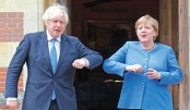 Britain's Prime Minister Boris Johnson (L) welcomes German Chancellor Angela Merkel on her arrival at Chequers, Buckinghamshire on Friday. Prime Minister Boris Johnson hosts Merkel at his Chequers country residence during her 22nd and last official visit to Britain before she steps down as chancellor later this year. – AFPPHOTO