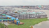 Launches are docked at Sadarghat Launch Terminal in the capital as public transport services remain suspended amid the countrywide complete lockdown aimed at curbing the surge in coronavirus cases. The photo was taken on Saturday.—MD NASIR UDDIN