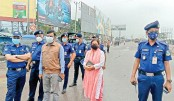 Members of Mymensingh district police led by Superintendent of Police Md Ahamar Uzzaman are active on a street the fourth day of the weeklong lockdown imposed to check the spread of coronavirus. The photo was taken from Patgudam Bridge in the town on Sunday.— Sun Photo