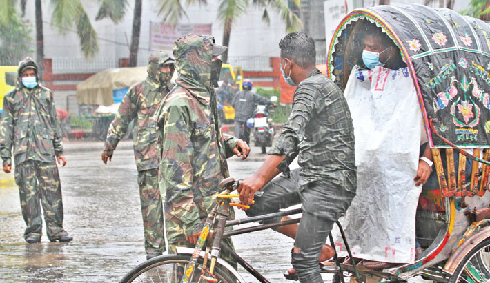 Amid incessant rain, army personnel check whether the rickshaw passengers have a valid reason to come out during the strict lockdown in Chattogram city on Tuesday. —RABIN CHOWDHURY