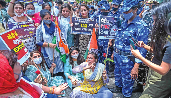 India's Congress party supporters shout slogans against the Bharatiya Janata Party (BJP) led central government during a protest against the hike in fuel prices in New Delhi on Wednesday. – AFP PHOTO