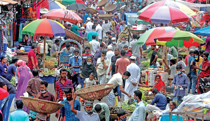 People are still paying no heed to health guidelines, including wearing masks and keeping distance from others, although the country continues to see a rise in both deaths and infections from coronavirus every day. The photo was taken from Karwan Bazar in the capital on Friday.—Reaz Ahmed Sumon