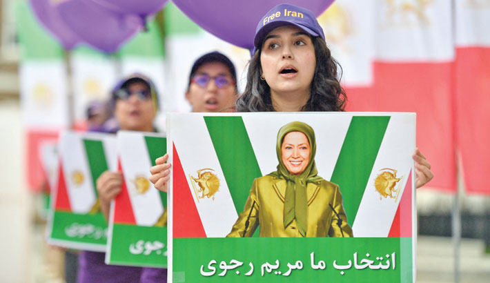 Members of the Anglo-Iranian Community hold placards of president of the National Council of Resistance of Iran (NCRI), the main opposition to Iran's rulers, Maryam Rajavi, during a rally supporting the Iranian people's struggle for a free and democratic Iran, opposite Downing Street in central London on Saturday. AFP PHOTO