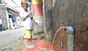 Water flows continuously from a Wasa line, which has no tap, beside a road in Old Dhaka's Agamasi Lane area. A huge quantity of water is being wasted every day but there is none to see it. The photo was taken on Sunday.—Md Nasir Uddin