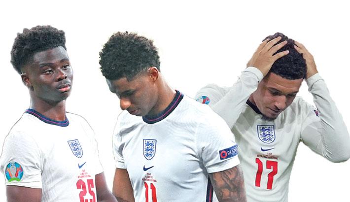 UK condemns racial abuse of England football stars