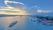 Blue sky is reflected in the river Buriganga, giving it a spectacular look. The photo was taken from Postogola Bridge area in the capital on Monday.—Kamrul Islam Ratan