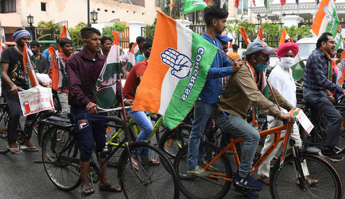 Activists of Congress party ride bicycles as they shout slogans against the price hike of Liquefied Petroleum Gas (LPG) and fuel in Amritsar on July 13, 2021.