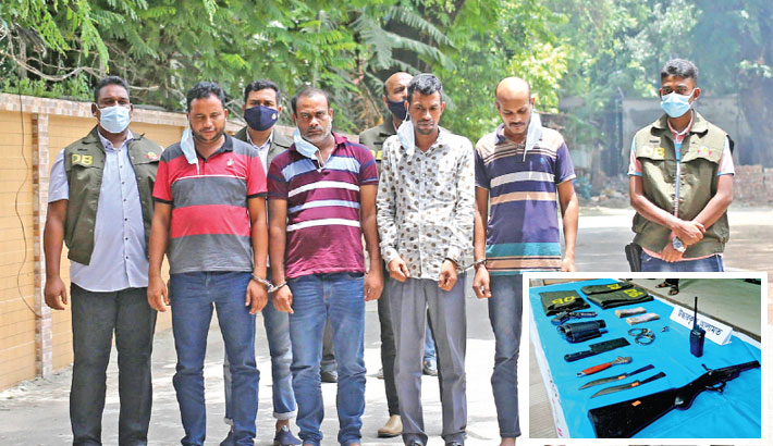 Detectives on Thursday produce four robbers, who in guise of the members of law enforcing agencies had been robbing people by setting up check posts on roads, before journalists after arresting them from the city's Mohammadpur area on Tuesday. Inset, a gun, a machete, two knives, three DB jackets, a toy pistol, a wireless set, a pair of handcuff and cash were seized from their possession. — SUN photo