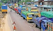 Vehicles, mostly goods-laden trucks, lorries and covered vans get stuck in a long tailback on Sylhet-Cumilla highway in Brahmanbaria on Wednesday.— Sun Photo