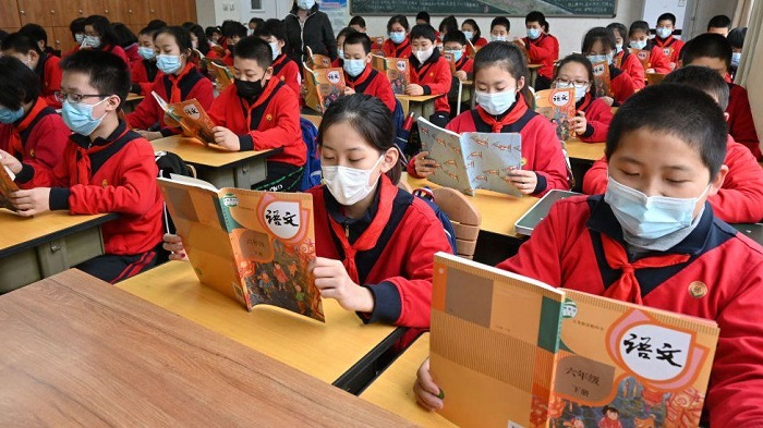 Chinese authorities say unvaccinated parents can't send children to school