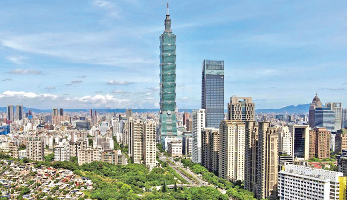 This general view shows the 508-metre (1,667-ft.) tall Taipei 101 commercial building (C) in Taipei on Friday.
