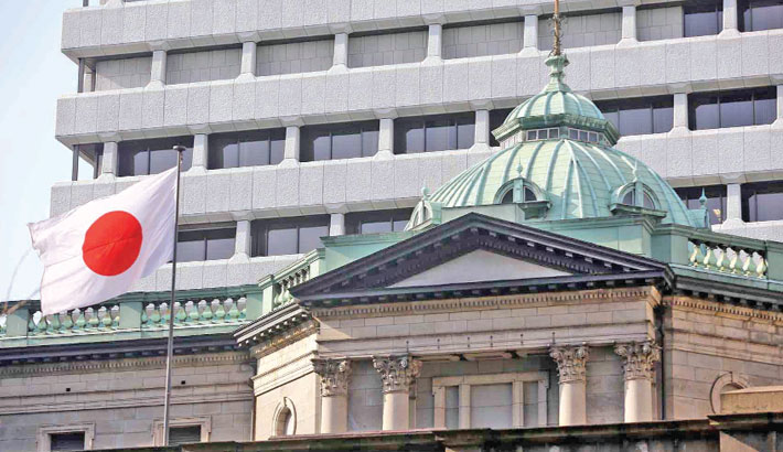 BoJ revises down GDP forecast