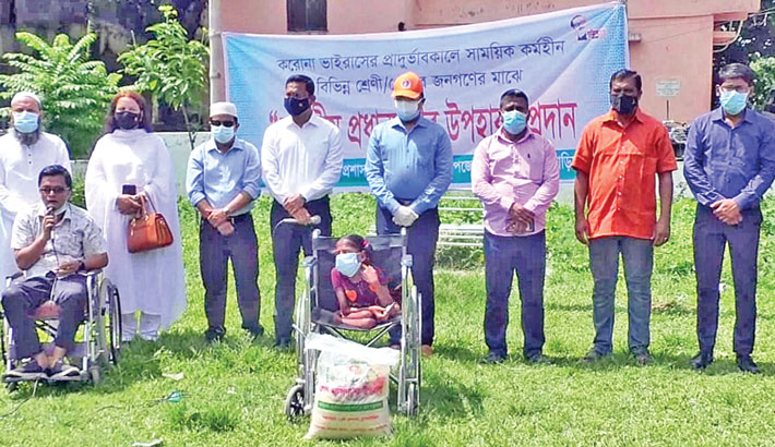 On behalf of Prime Minister Sheikh Hasina, Deputy Commissioner of Brahmanbaria Hayat-Ud-Dowllah Khan hands over Eid gifts and relief materials to people with disability at Faruque Park Square in the district town on Sunday. —Sun Photo