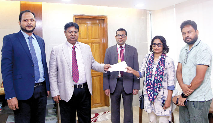 South Bangla Agriculture and Commerce Bank Managing Director and CEO Mosleh Uddin Ahmed hands over six cheques to Mehmankhana Founder Asma Aktar Liza to provide food to the distressed people at the bank's head office in the capital on Sunday.