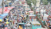 Vehicles get stuck in a tailback in the capital's Gulistan area on Sunday, causing immense sufferings for commuters and homebound people.  Reaz Ahmed Sumon