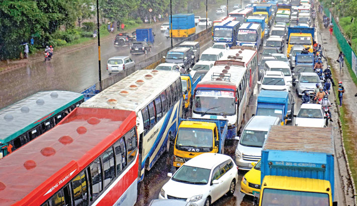 Dhaka city witnesses severe traffic congestion on different roads on Monday, causing immense sufferings for commuters and homebound people. The photo was taken from Airport Road in the capital.—sun photo