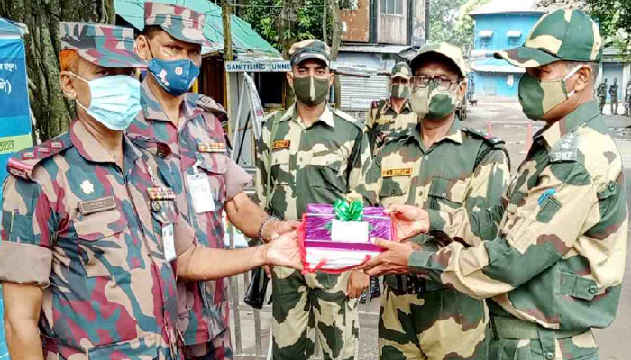 Border guards exchange sweets and Eid greetings at Hili border