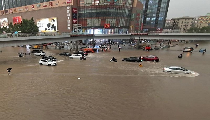 Flooding in central China turns streets to rivers, kills 12