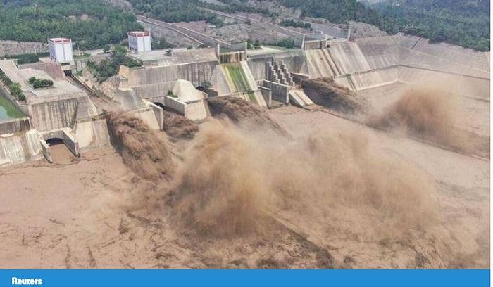 Dozen central Chinese cities go underwater as river banks burst