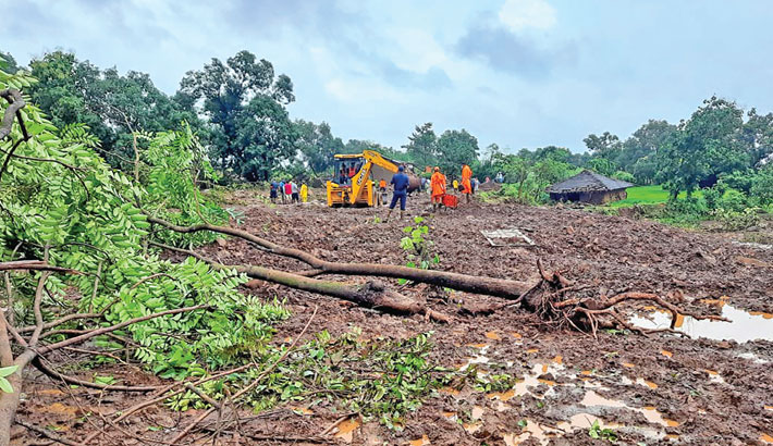 Indian National Disaster Response Force (NDRF) personnel look for survivors at the landslide site in Taliye village near Mahad after heavy monsoon rains in Raigad district of Maharashtra. The handout picture was taken on Saturday.—AFP PHOTO
