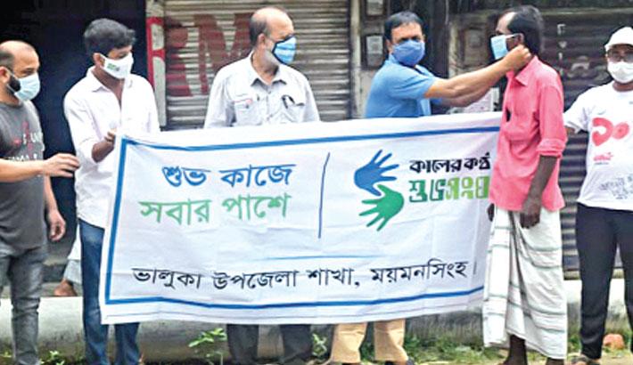 Shuvasangha distributes masks in Bhaluka