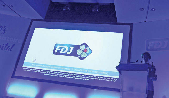 This file photo taken recently shows a France's lottery and scratch cards monopoly Francaise des Jeux (FDJ) logo during a press conference in Boulogne-Billancourt, west of Paris, on the day of the opening of the sale of shares. Brussels announced on Monday the opening of an in-depth investigation into the granting of exclusive rights to Française des Jeux (FDJ) by the French state to operate lotteries and sports betting for 25 years.