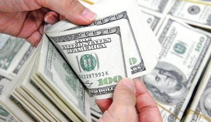 Dollar holds near multi-month highs