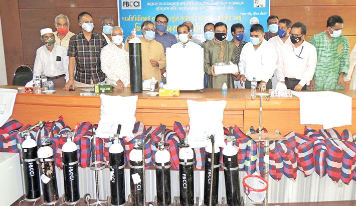 Senior Vice President of Federation of Bangladesh Chamber of Commerce and Industries (FBCCI) Mostofa Azad Chowdhury Babu and President of Rangpur Chamber of Commerce and Industry (RCCI) Mostafa Sohrab Chowdhury Titu hands over 10 oxygen cylinders (full sets), 2 hi-flow nasal cannula, 500 hi-flow NBR masks and 10 high-flow by-pap masks to Civil Surgeon of Rangpur Dr Herambo Kumar Roy at a programme held in the RCCI Board Room on Tuesday. – Sun Photo