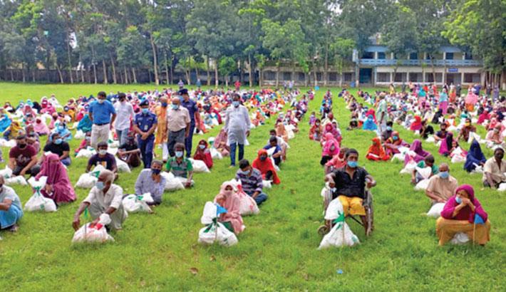 Bashundhara Group distributes relief among poor families in Bogura