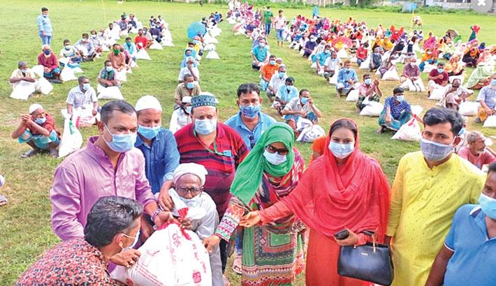 Bashundhara Group distributes relief among helpless people