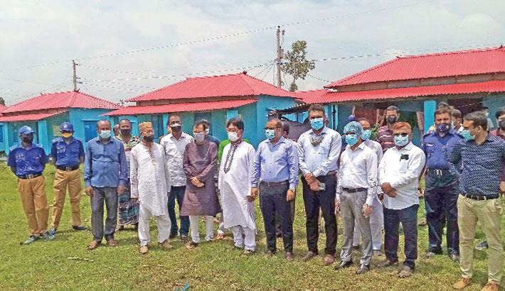 Dinajpur district council chairman Azizul Imam Chowdhury and deputy commissioner Khaled Mohammad Zaki visit the largest Asrayan Project at Balupara village under Khaerbari union of Fulbari upazila in Dinajpur district on Saturday. – Sun Photo