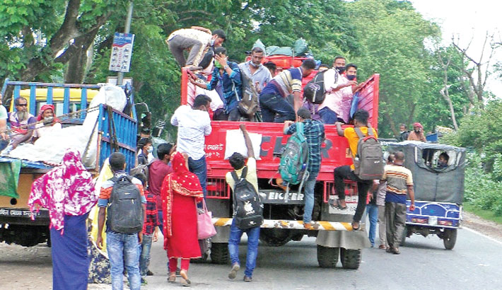 Dhaka-bound people make desperate journey by a truck following the announcement of resumption of different factories in the capital. The photo was taken from central bus terminal in Jhenaidah district town on Saturday morning.– Sun Photo