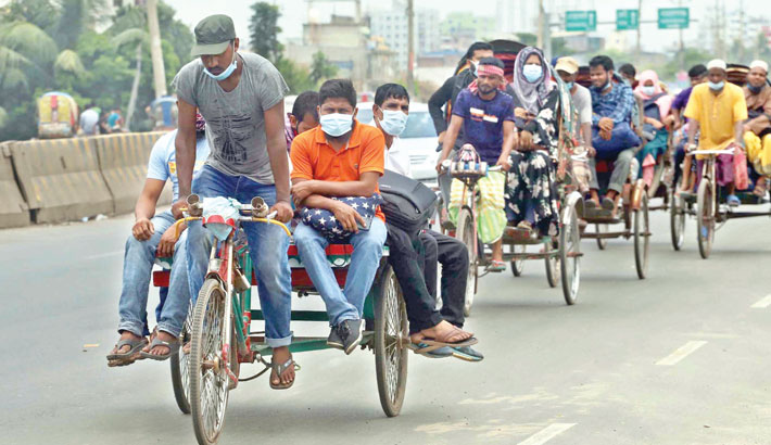 Working people from different districts of the country are returning to Dhaka for joining their workplaces after the  government's announcement for reopening of export-oriented RMG and non-RMG factories from today. The photo was taken from Sanirakhra area in the capital on Saturday. sun photo