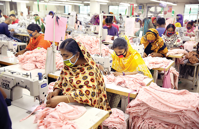 Factories reopen amid Covid surge as 'economy falters'