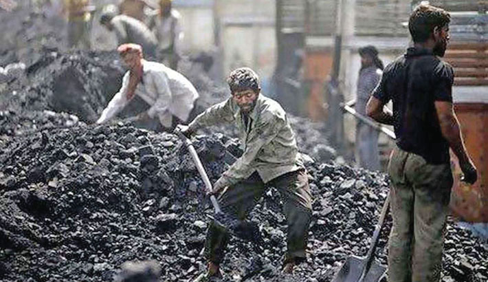 Labourers load coal onto trucks at a depot on the outskirts of Jammu, in Jammu and Kashmir. India depends on coal for 65 per cent of its power generation needs.