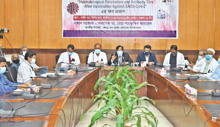 Vice-Chancellor of Bangabandhu Sheikh Mujib Medical University Prof Dr Md Sharfuddin Ahmed presents the result of a research on 'Haematological Parameters and Antibody Titre after Vaccination against SARS-CoV-2' on the campus on Monday.