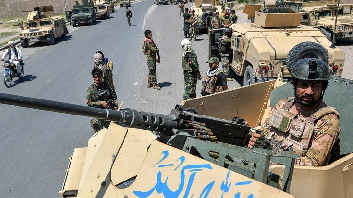 Afghan forces battle Taliban in fight for besieged cities