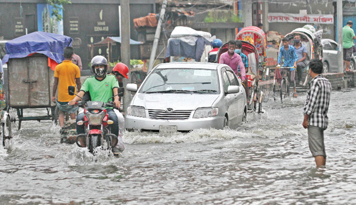 A road in Badurtala area of Chattogram city goes under knee-deep water after heavy rain on Tuesday, causing immense sufferings for commuters. The photo was taken on Tuesday. — Rabin chowdhury