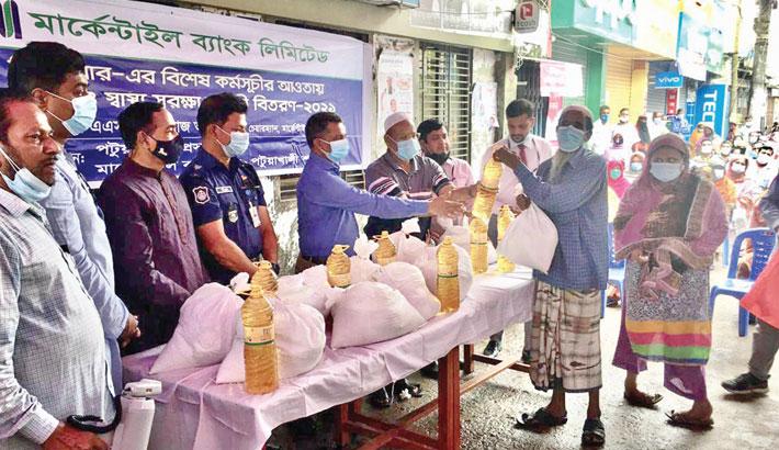 Mercantile Bank distributes food among 250 families in Patuakhali