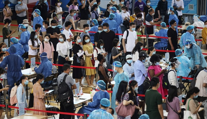 China mass testing shows virus cases at six-month high